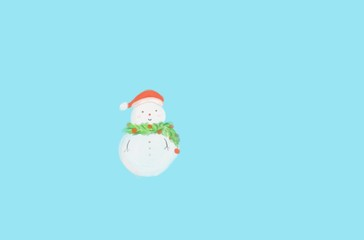 Cute digital hand draw snowman was decorated with garland and Christmas hat