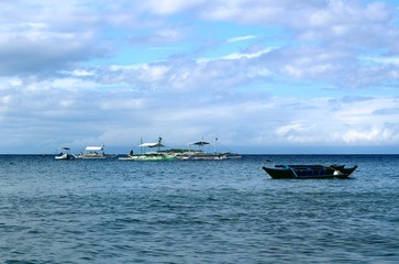 Boats in the sea in the Philippines waiting for tourists to travel around the islands