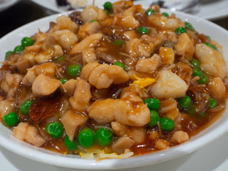 Fried rice topped with minced beef in special curry sauce in Hong Kong restaurant popular menu people like to order