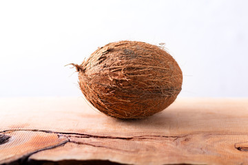 Whole single organic Tropical coconut  fruit on wodden background with copy space