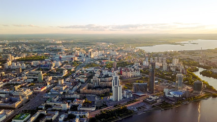 General panorama of the city of Yekaterinburg with embankment and skyscrapers, Russia, From Dron