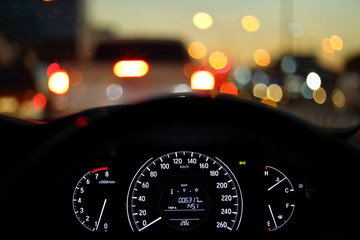 speedometer in modern vehicle car drive travel road trip in night city