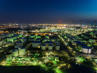 Oil refinery factory at dusk for energy or gas industry or transportation background.