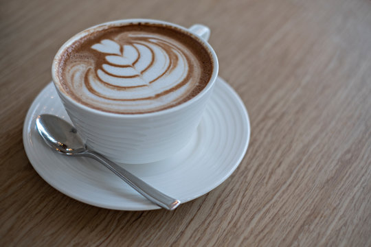 Cup of coffee latte art.