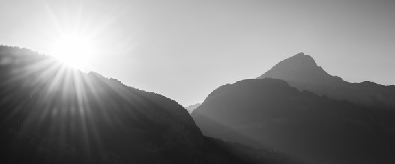 Sun in the mountains. Black and white
