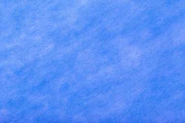 Dark blue background of felt fabric. Texture of woolen textile