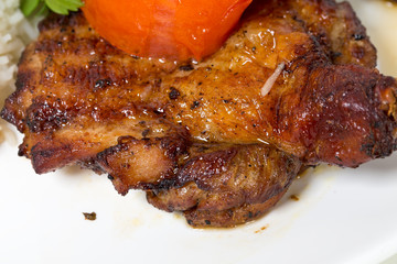 Grilled chicken tabaka with tomato.