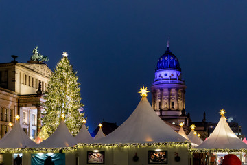 Christmas stalls for food, drinks and gifts in Gendarmenmarkt Christmas Market in Berlín, Germany.