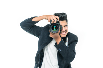 Young indian Asian man with camera isolated on white background. Photographer concept