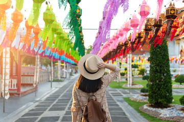 A woman tourist is enjoy traveling at Wat Benchamabophit Dusitvanaram Marble Temple Bangkok during decoration with Yipeng Lanterns festival.