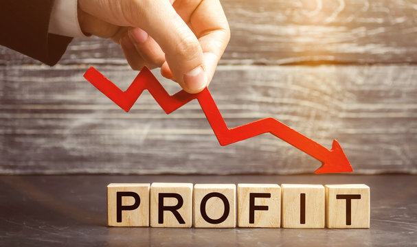 A businessman holds a red arrow to down and the inscription profit. Unsuccessful business and poverty. Profit decline. Loss of investment. Low wages. Economic crisis. The fall of the financial market