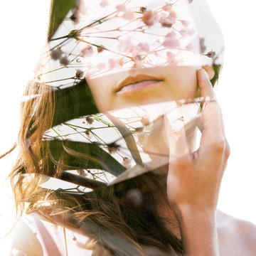 Double exposure portrait of a young sexy girl with flawless skin combined with delicate flower petals