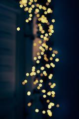Blurring lights bokeh background of stars at christmastime