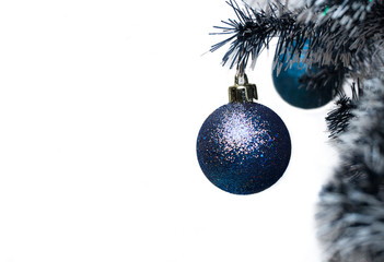 Blue Christmas ball hanging on Christmas tree. Christmas decoration. Christmas winter background. Christmas, New Year  concept.