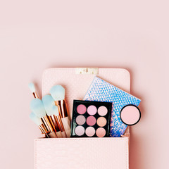 Makeup bag with cosmetic beauty products. Flat lay, top view. Beauty and Fashion concept .