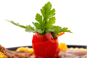 Tomato and parsley on chicken tabaka.
