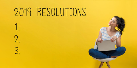 2019 Resolutions with young woman using a laptop computer