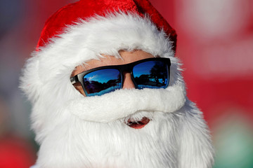 "A man dressed as Santa Claus takes part in the annual race known as ""Run Santa Run"" at Fundidora Park in Monterrey"
