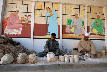 Workers carve pots from alabaster in Luxor