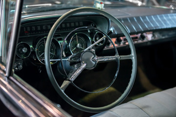 Dashboard with steering wheel of a classic car from the 1970's