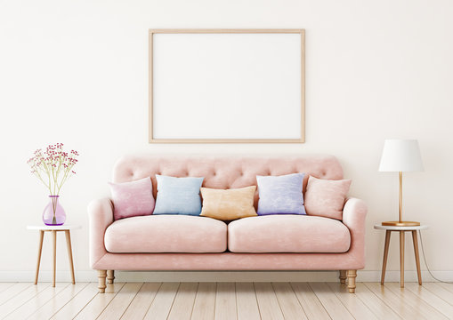 Poster mockup with horizontal frame on empty wall in living room interior with pink sofa and multi-colored pastel pillows. 3D rendering.