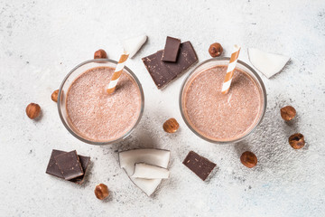 Chocolate coconut hazelnut milkshake or smoothie top view.
