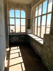 ghost town kolmanskop - view through the ruins in the desert - Namibia
