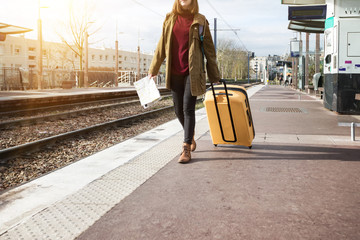 girl tourist  waits for the train