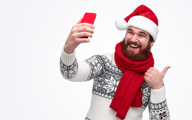 modern Santa waiting for christmas and taking a selfie picture isolated on white