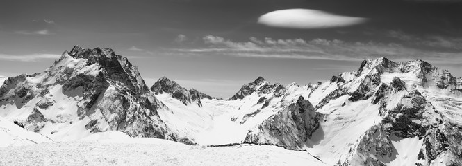 Fototapete - Black and white panorama of snowy mountains and sky with clouds