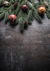 Top of view christmas decorations jingle bells fir tree pine cones on free concrete background