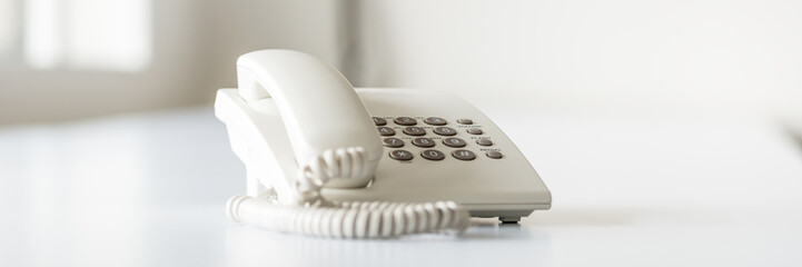 Wide view image of white landline telephone