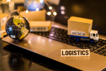Logistics Supply Chain Challenges - still life logistics business concept with laptop, phone, mini shipping cartons
