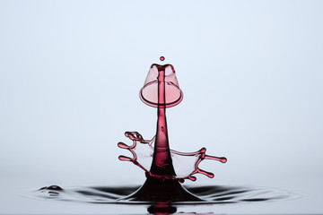 red abstract waterdrop sculpture formed after collision