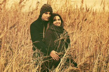 Happy young fashion couple in love walking outdoor