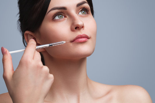 Flawless woman doing botox injection