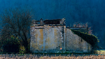 old decaying house in late autumn landscape