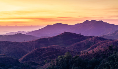 Colorful landscape view in early morning before the sunrise with misty covered mountain hills at Thong Pha Phum. Kanchanaburi, Thailand
