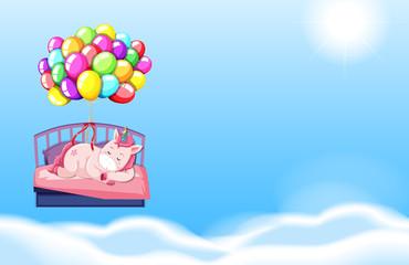 Unicorn sleeping in bed sky background
