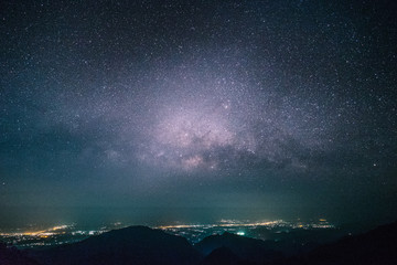 City landscape at nigh with sky filled with stars in huai nam dang, Chiang Mai, North of Thailand.