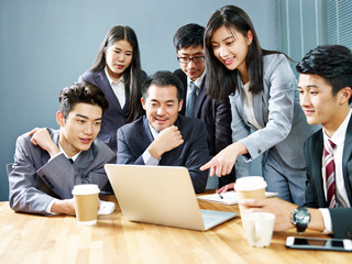 asian corporate people reviewing business results