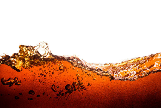 cola soda with sparkling bubbles isolated on white
