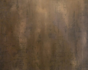 Shiny gold foil, bronze, or copper metal pattern surface texture. Close-up of interior material for...