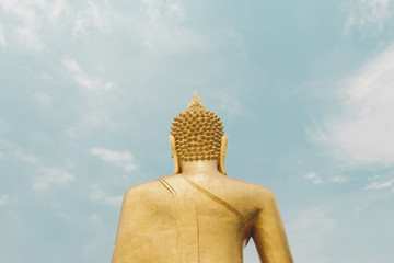 Big gold buddha with statue - the symbol of buddhism at the Pattaya, Thailand