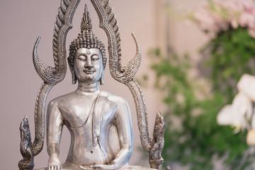 Thai wedding ceremony decoration with monk statue