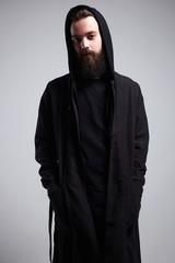 Fashionable Man in Hood. Bearded Handsome Boy