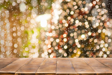 Christmas holiday background with empty wooden table top over festive bokeh light for product presentation.