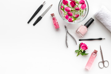 Aluminium Prints Manicure manicure equipment with nail polish and rose petals white background top view space for text
