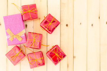 Blurry Gift Box on wood background,holiday and happy time.