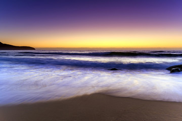 Beach, Headland and glowing Dawn Seascape